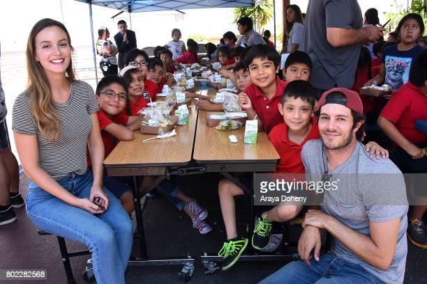 Leighton Meester and Adam Brody volunteer at Feeding America's Summer Hunger Awareness event At Para Los Ninos in Los Angeles on June 27 2017 in Los...