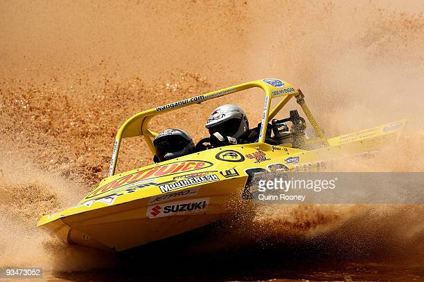 Leighton Minnell and Kellie Minnell of New Zealand compete in their boat Hummertime during the 2009 World Jetsprint Championships at the Melton...