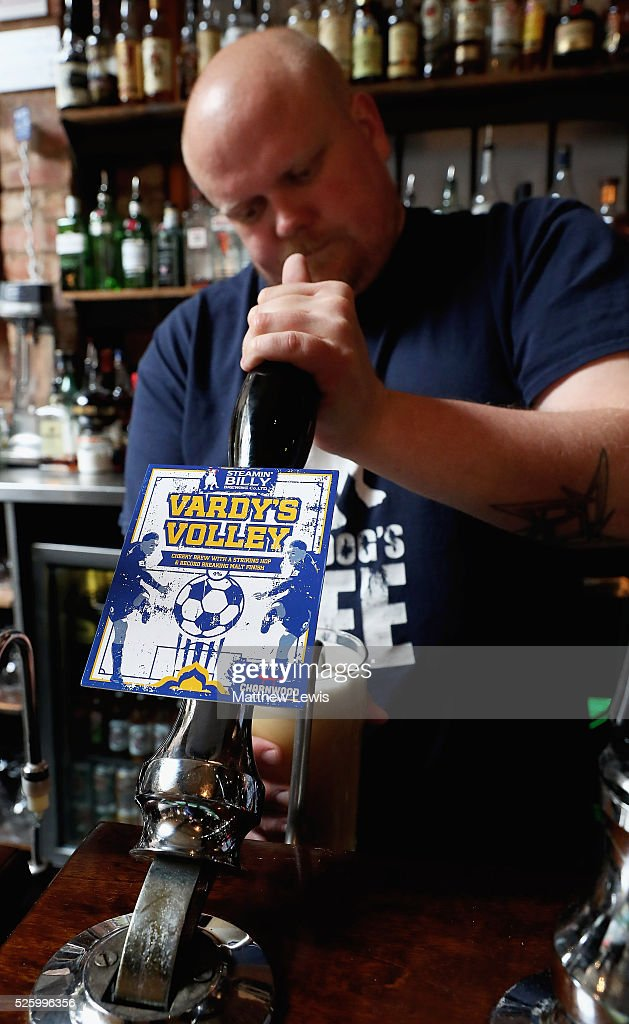 Leighton Turner, landlord at the Steamin Billy Parcel Yard pub pulls a pint of 'Vardy's Volley', as they show their support towards Leicester City FC during a Leicester Backing the Blues Campaign in support of Leicester City on April 29, 2016 in Leicester, England.