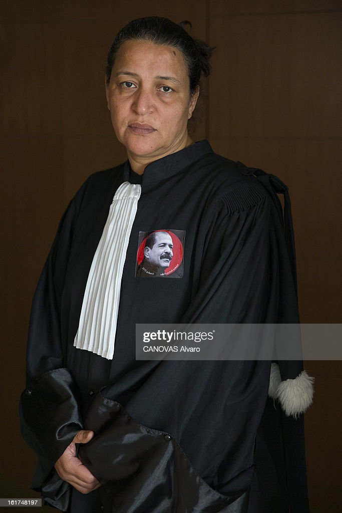 Leila Ben Debba figurehead of the revolution of 14 January 2011 and companion of struggle of Chokri Belaid, focuses on her dress as a lawyer a badge bearing the image of her murdered friend on February 9, 2013 in Tunis,Tunisia.