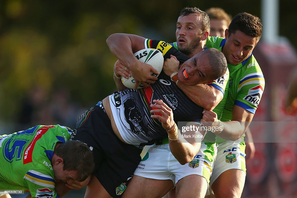 Leilani Latu of the Panthers is tackled during the round nine NRL match between the Penrith Panthers and the Canberra Raiders at Carrington Park on April 30, 2016 in Bathurst, Australia.