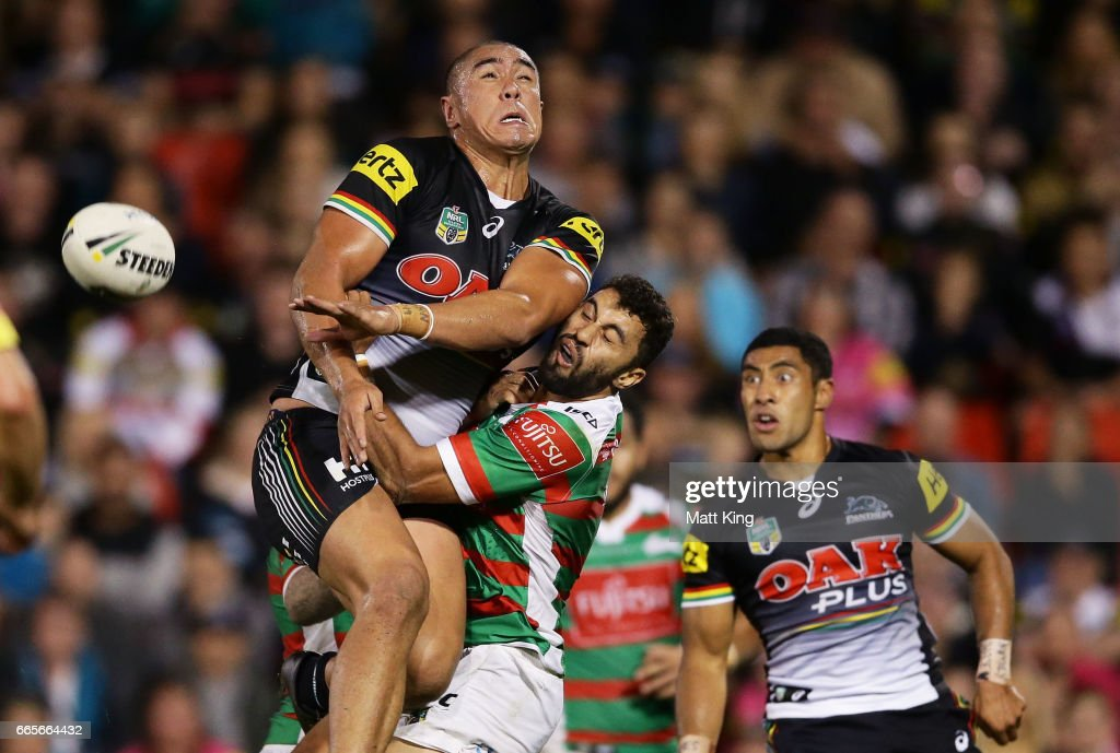 Leilani Latu of the Panthers runs into Alex Johnston of the Rabbitohs contesting a high ball during the round six NRL match between the Penrith Panthers and the South Sydney Rabbitohs at Pepper Stadium on April 7, 2017 in Sydney, Australia.