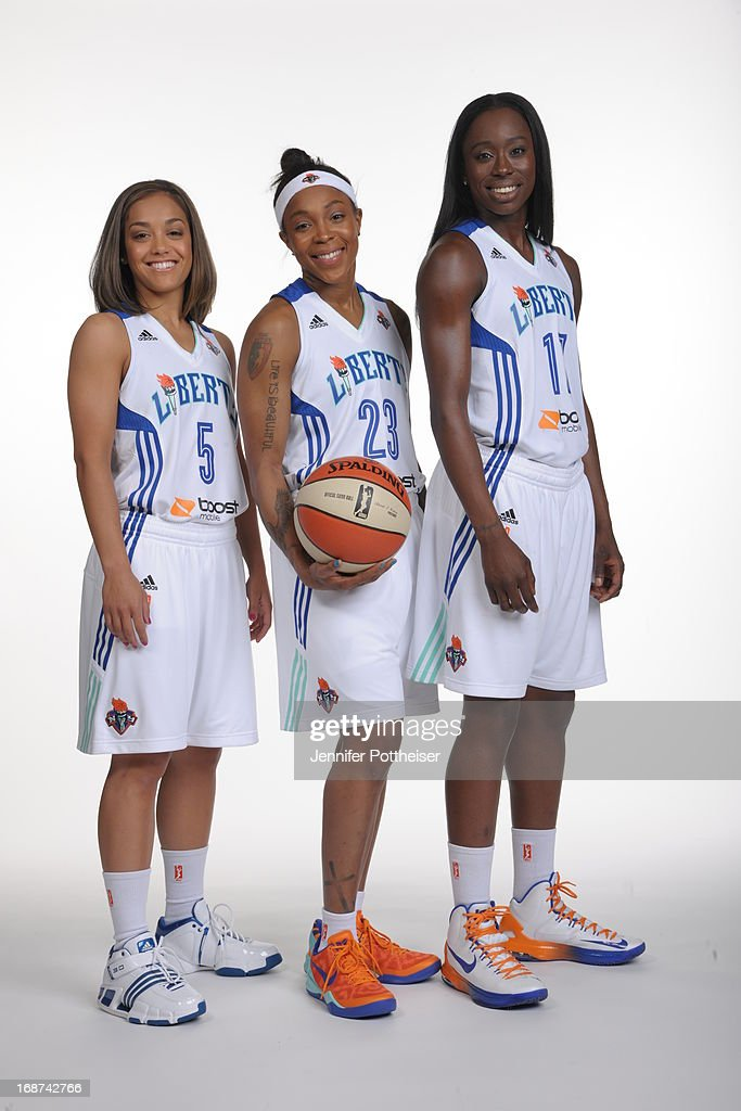 Leilani Mitchell #5, Cappie Pondexter #23 and Essence Carson #17 of the New York Liberty poses for a photo during WNBA Media Day on May 13, 2013 at the Madison Square Garden Training Facility in Tarrytown, New York.