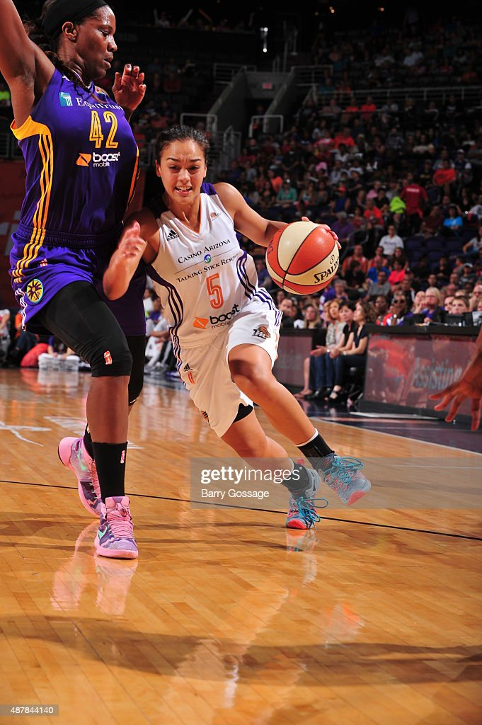 Leilani Mitchell #5 of the Phoenix Mercury drives against Jantel Lavender #42 of the Los Angeles Sparks on September 11, 2015 at the US Airways Center in Phoenix, Arizona.