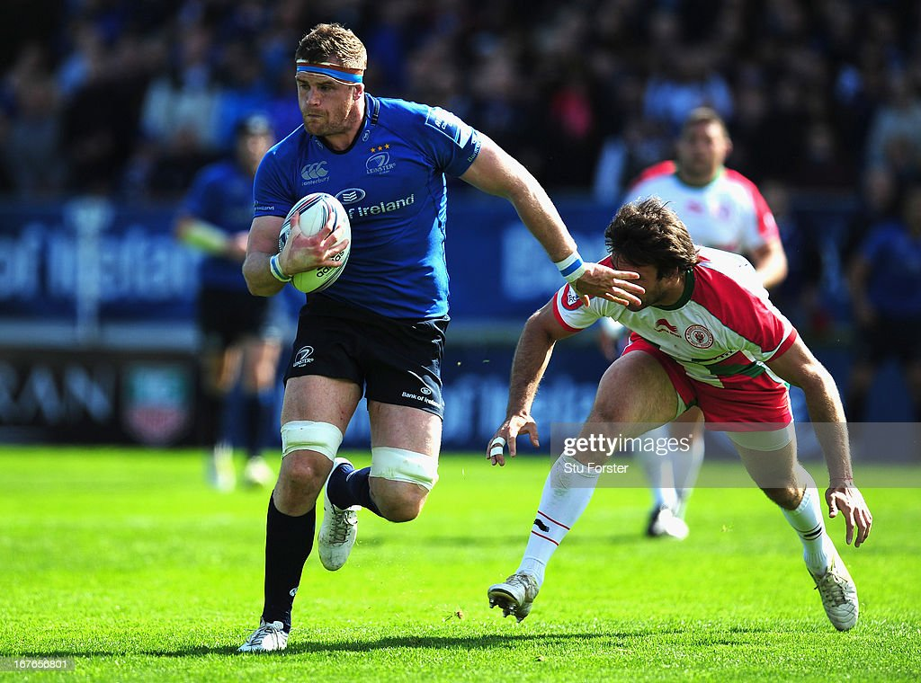 Leinster captain Jamie Heaslip breaks through to score his second try during the Amlin Challenge Cup Semi Final match between Leinster and Biarritz Olympique at Royal Dublin Society on April 27, 2013 in Dublin, Ireland.