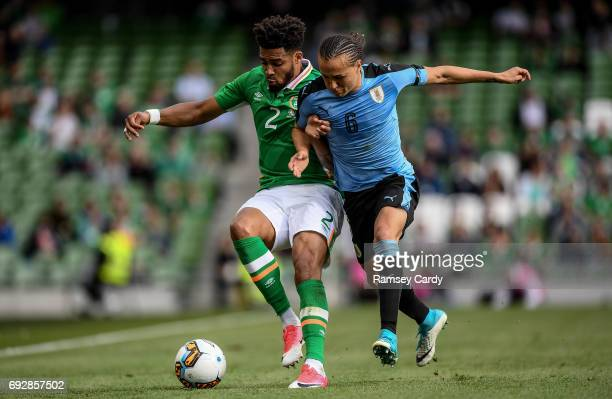 Leinster Ireland 4 May 2017 Cyrus Christie of Republic of Ireland is tackled by Diego Laxalt of Uruguay during the international friendly match...