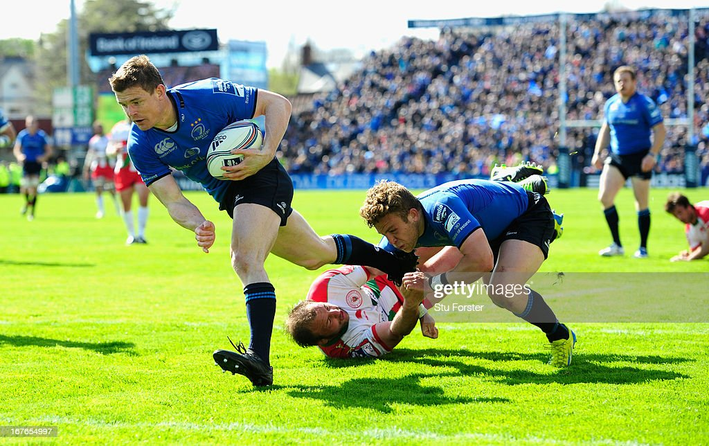 Leinster player Brian O' Driscoll bursts through for his try during the Amlin Challenge Cup Semi Final match between Leinster and Biarritz Olympique at Royal Dublin Society on April 27, 2013 in Dublin, Ireland.