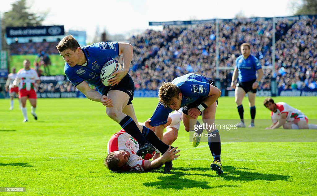 Leinster player Brian O' Driscoll crosses for his try during the Amlin Challenge Cup Semi Final match between Leinster and Biarritz Olympique at...