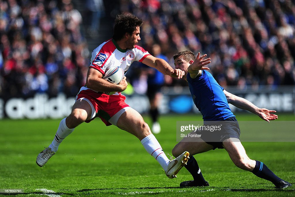 Leinster player Brian O' Driscoll (r) puts in a tackle on Biarritz Fullback Marcelo Bosch during the Amlin Challenge Cup Semi Final match between Leinster and Biarritz Olympique at Royal Dublin Society on April 27, 2013 in Dublin, Ireland.