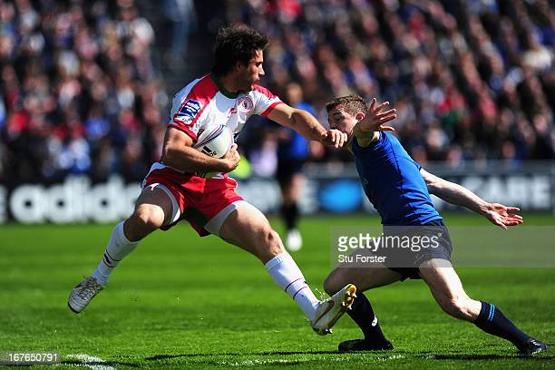 Leinster player Brian O' Driscoll puts in a tackle on Biarritz Fullback Marcelo Bosch during the Amlin Challenge Cup Semi Final match between...