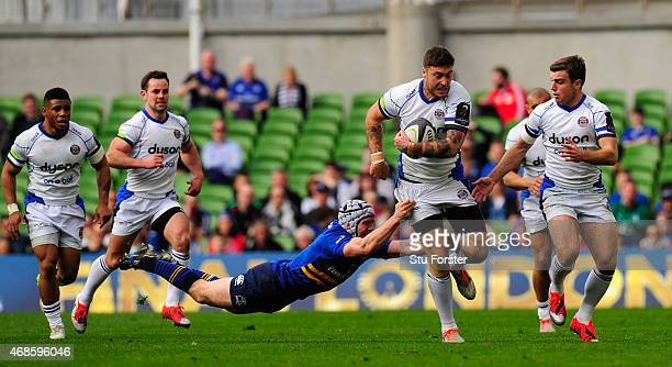 Leinster player Isaac Boss attempts to tackle Matt Banahan during the European Rugby Champions Cup Quarter Final match between Leinster Rugby and...