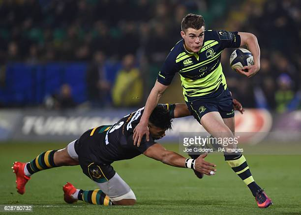 Leinster Rugby's Garry Ringrose breaks the tackle of Northampton Saints' Luther Burrell during the European Champions Cup match at Franklin's Gardens...