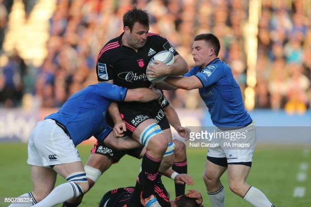 Leinster's Andrew Conway tackles Stade Francais' David Lyons during the Amlin Challenge Cup Final match at the RDS Dublin Ireland PRESS ASSOCATION...
