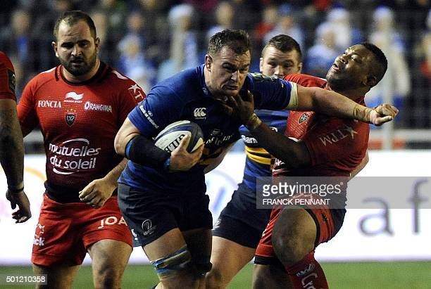Leinster's Irish back row Rhys Ruddock challenges Toulon's English flanker Steffon Armitage during the European Rugby Champions Cup rugby union match...