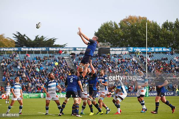 Leinster's Irish lock Devin Toner wins a line out during the European Rugby Champions Cup rugby union match between Leinster and Castres in Dublin on...