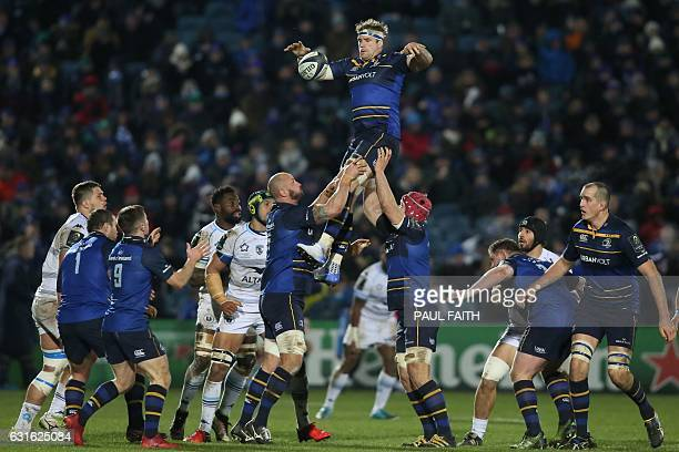 Leinster's Irish number 8 Jamie Heaslip jumps to win the ball in the lineout during the European Rugby Champions Cup rugby union Pool 4 match between...