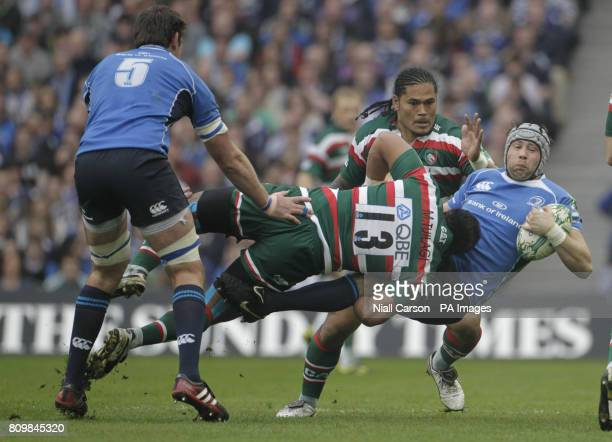 Leinster's Kevin McLaughlin is tacked by Leicester's Manu Tuilagi during the Heineken Cup Quarter Final match at the Aviva Stadium Dublin