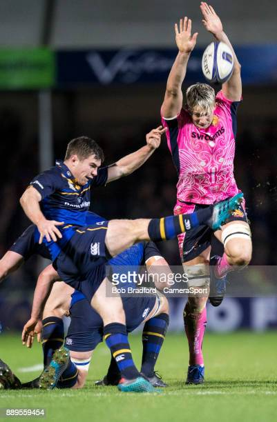 Leinster's Luke McGrath is almost charged down by Exeter Chiefs' Jonny Hill during the European Rugby Champions Cup match between Exeter Chiefs and...