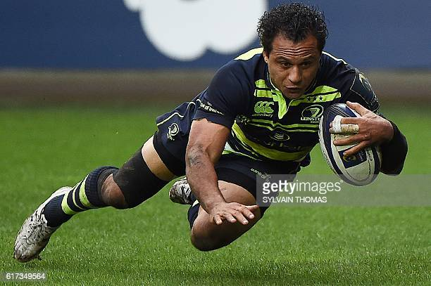 Leinster's New Zealand wing Isa Nacewa scores a try during the European Rugby Champions Cup rugby match between Montpellier and Leinster at the...