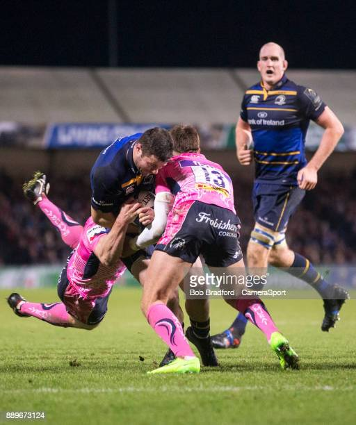 Leinster's Robbie Henshaw is tackled by Exeter Chiefs' Henry Slade during the European Rugby Champions Cup match between Exeter Chiefs and Leinster...