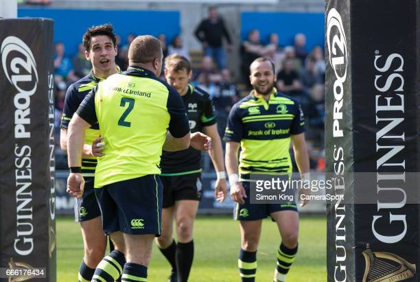 Leinster's Sean Cronin celebrates scoring his sides first try with teammate Joey Carbery during the Guinness Pro12 Round 19 match between Ospreys and...