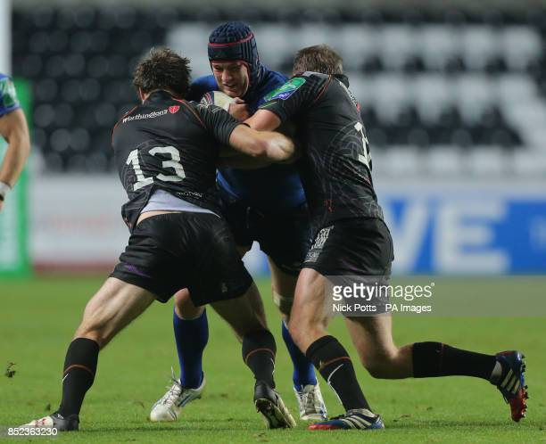 Leinster's Sean O'Brien is held by Ospreys pair Andrew Bishop and Dan Bigger during the Heineken Cup match at the Liberty Stadium Swansea