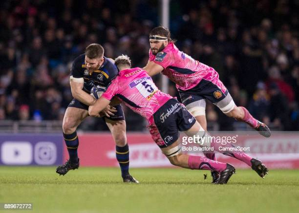 Leinster's Sean O'Brien is tackled by Exeter Chiefs' Jonny Hill during the European Rugby Champions Cup match between Exeter Chiefs and Leinster...