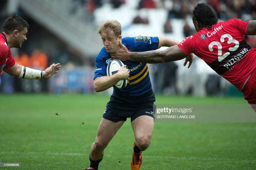 Leinster's wing from Ireland Luke Fitzgerald (C) is tackled by RC Toulon's lock Jocelino Suta (R) during the European Champions Cup rugby union semi final match between Toulon and Leinster on April 19, 2015 at the Velodrome stadium in Marseille, souheastern France.