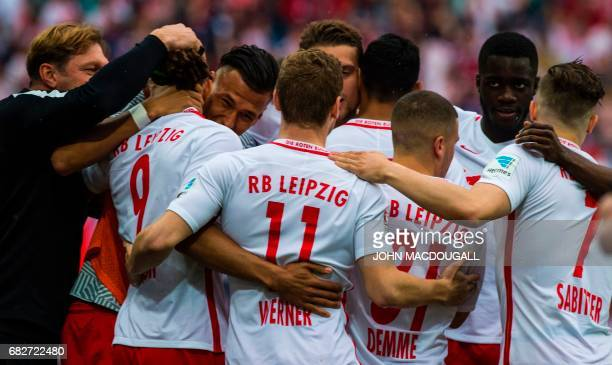 Leipzi players celebrate with Leipzig's head coach Ralph Hasenhuettl after Leipzig's Danish forward Yussuf Poulsen scored during the Bundesliga match...