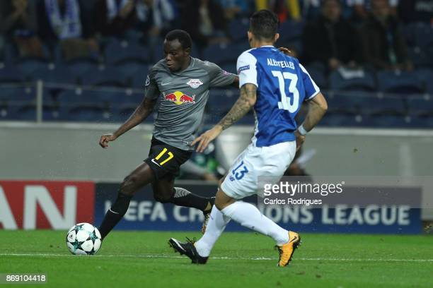 Leipzig forward Bruma from Portugal tries to escape FC Porto's defender Alex Telles from Brazil during the match between FC Porto v RB Leipzig or the...