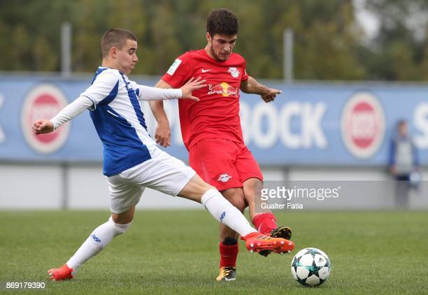 Leipzig forward Elias Abouchabaka from Germany with FC Porto forward Paulo Estrela in action during the UEFA Youth League match between FC Porto and...