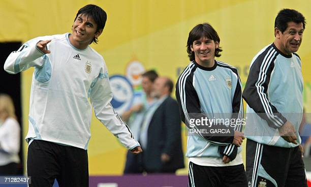 Argentine forward Lionel Messi and assistant Ubaldo Fillol react while goalkeeper Oscar Ustari gestures during team's reconnaissance at Leipzig...