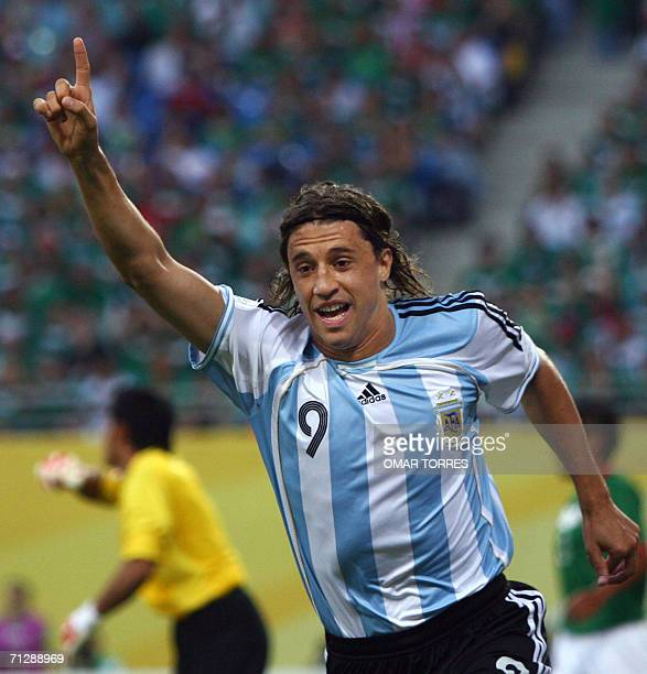 Argentinian forward Hernan Crespo celebrates after Mexican forward Jared Borgetti scored an own goal during the World Cup 2006 round of 16 football...