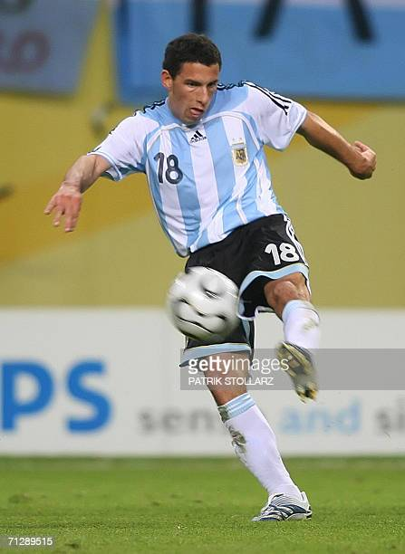 Argentinian midfielder Maxi Rodriguez volleys the ball to score a goal during the extra time of the World Cup 2006 round of 16 football game...