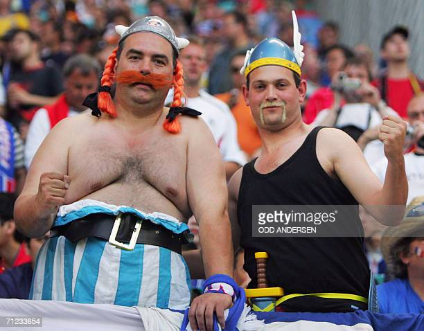 French supporters wearing costume of Asterix and Obelix are pictured prior to the World Cup 2006 group G football game France vs South Korea 18 June...