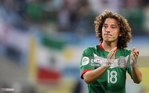Mexican defender Andres Guardado applauds his team's supporters at the end of the World Cup 2006 round of 16 football game Argentina vs Mexico 24...