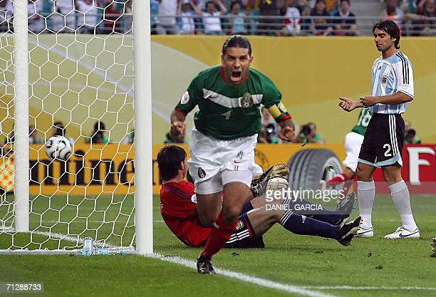 Mexican defender Rafael Marquez celebrates his opening goal next to Argentinian goalkeeper Roberto Abbondanzieri during the World Cup 2006 round of...