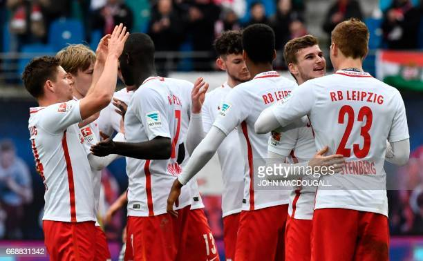 Leipzig players celebrate after the German First division Bundesliga football match between RB Leipzig and SC Freiburg in Leipzig eastern Germany on...