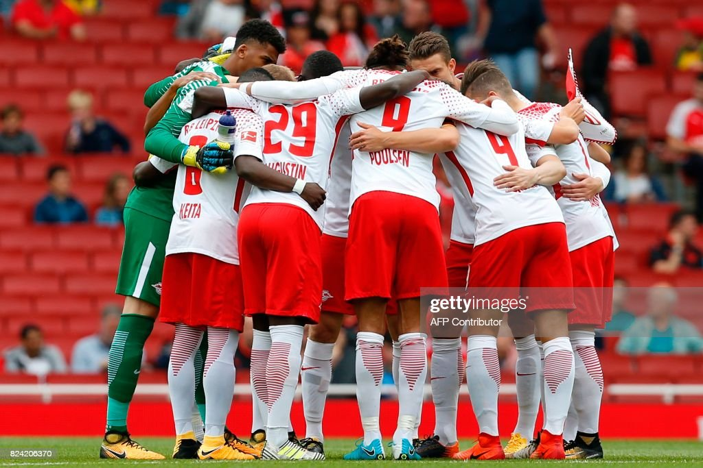 Leipzig players huddle before kick off of the pre-season friendly football match between RB Leipzig and Sevilla at The Emirates Stadium in north London on July 29, 2017, the game is one of four matches played over two days for the Emirates Cup. / AFP PHOTO / Ian KINGTON