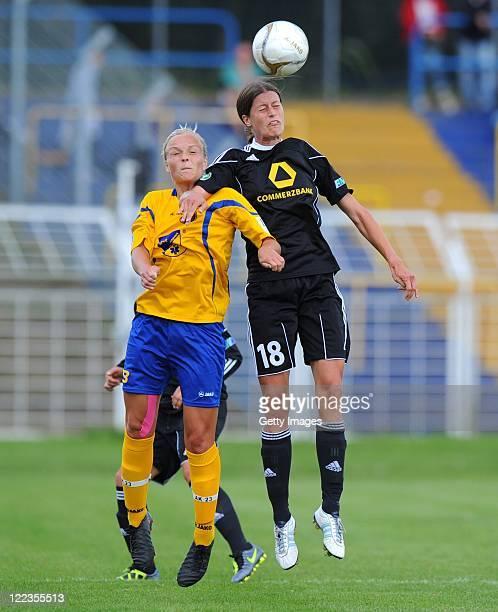 Leipzig's AnnKatrin Schinkel jumps for a header with Kerstin Garefrekes of Frankfurt during the Women's Bundesliga match between 1 FC Lok Leipzig and...
