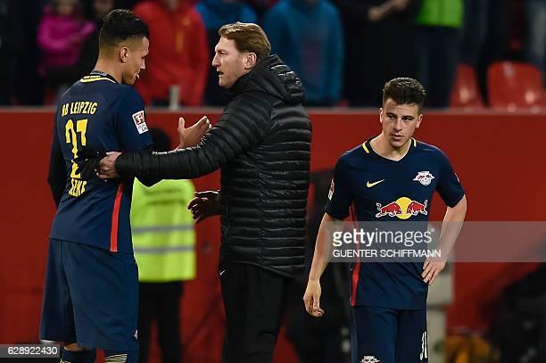 Leipzig's Austrian head coach Ralph Hasenhuettl and Leipzig's German striker Davie Selke talk after the German first division Bundesliga football...