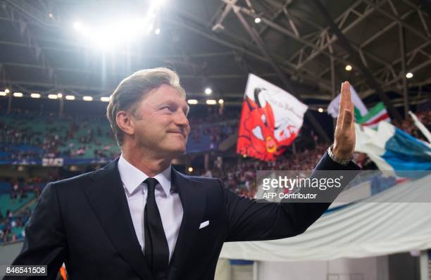 Leipzig's Austrian head coach Ralph Hasenhuettl waves as he arrives for the Champions League group G football match RB Leipzig v AS Monaco in Leipzig...