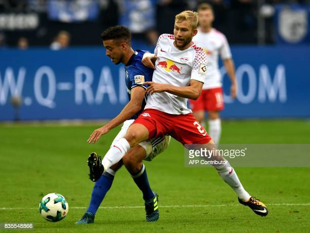 Leipzig's Austrian midfielder Konrad Laimer and Schalke's Argentinian forward Franco di Santo vie for the ball during the German First division...