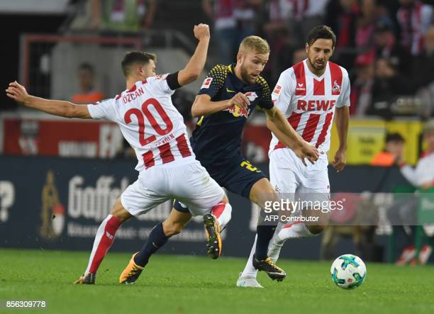 Leipzig's Austrian midfielder Konrad Laimer Cologne's German midfielder Salih Ozcan and Cologne´s Peruvian striker Claudio Pizarro vie for the ball...