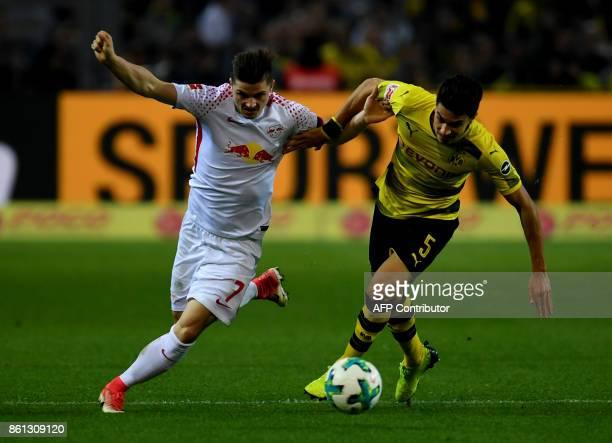 Leipzig's Austrian midfielder Marcel Sabitzer and Dortmund's Spanish defender Marc Bartra vie for the ball during the German first division...