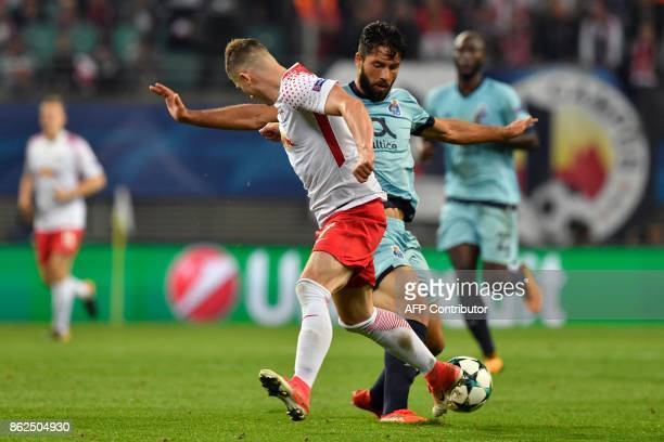 Leipzig's Austrian midfielder Marcel Sabitzer and Porto's Portuguese midfielder Sergio Oliveira vie for the ball during the UEFA Champions League...