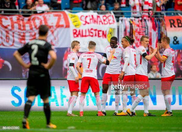 Leipzig's Austrian midfielder Marcel Sabitzer celebrates after scoring the first goal with his teammates during the German first division Bundesliga...