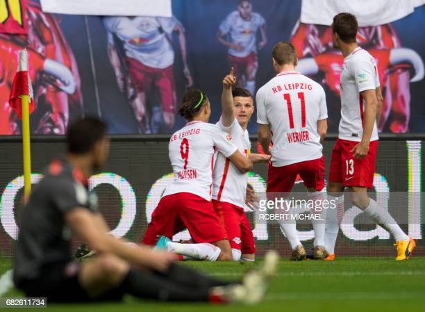 Leipzig's Austrian midfielder Marcel Sabitzer celebrates with teammates after scoring the 10 during the German first division Bundesliga football...