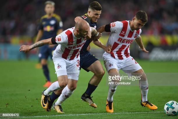 Leipzig´s Austrian midfielder Marcel Sabitzer Cologne's German midfielder Konstantin Rausch and Cologne's midfielder Salih Ozcan vie for the ball...