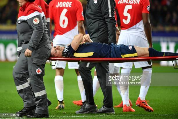 Leipzig's Austrian midfielder Marcel Sabitzer reacts as he is escorted out of the football field on a stretcher after an injury during the UEFA...